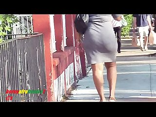 Ebony milf tight gray dress showing off that ass