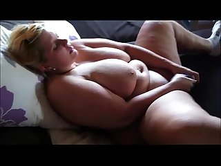 Fat blonde with huge boobs masturbates