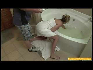Blonde stepmom blackmailed and forced while stuck in tub