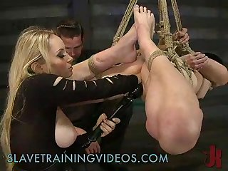 Bound suspended babe strap on toy fucked