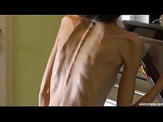 Skinny brunette posing naked