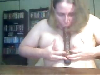 Fat amateur playing with a dildo
