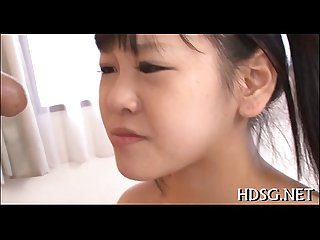 Oriental legal age teenager enjoys deepthroat