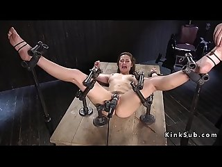 Slave in metal device bondage vibrated