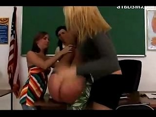 Teacher getting her ass spanked red by 3 schoolgirls in the classroom