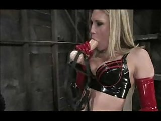 Bomndaged and used by nasty mistress in red latex