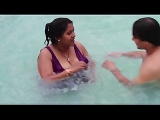 Hot sexy Desi Aunty showing assets in the pool