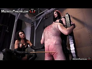 Two Femdom Mistresses cane male slave to his knees