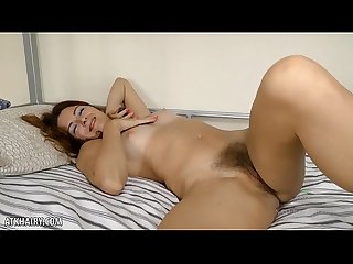 Watch Helen Volga playing with her hairy pussy