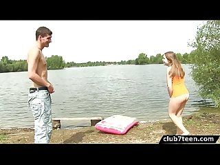 Hot teen has outdoor sex by the lake