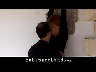 Slave in black suit hundcuffed for bondage fantasy