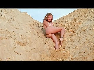 Hot babe plays with sand