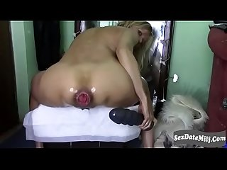 cougar fucks her ass with big dildo while smoking and squirting