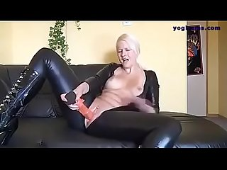 German blonde in latex fucks her self