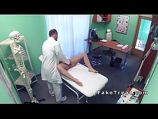 Doctor between legs of sexy blonde patient