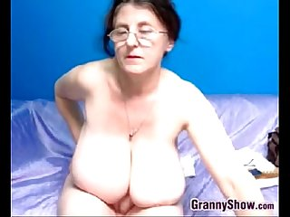 Naughty grandma with big tits masturbates