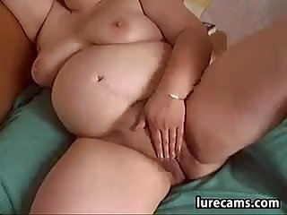 Fat Mature Whore Rubs Her Pussy