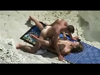 Hidden cam films hot couple fucking in the beach