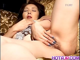 Reiko hanasaki rubs pussy with long nails and puts vibrator on it