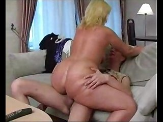 Busty mom and slim boy watching tv