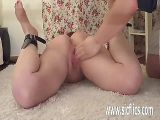 Brutally fisting his hogtied gf in bondage
