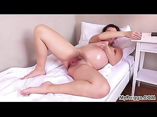 Pregnant corazon oiled up and Masturbating excl