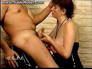 Slave sucks cock of her master and gets hit with a whip