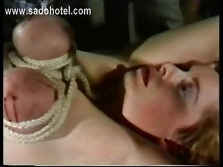 Slave with her big tits tied together got her pussy licked by another slave