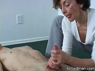 Oldie mistress is able to extract young man s cum
