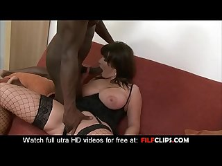 Sexy busty mature ride on a huge Black cock