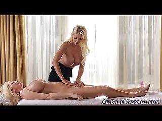 Busty masseuse rubs clit