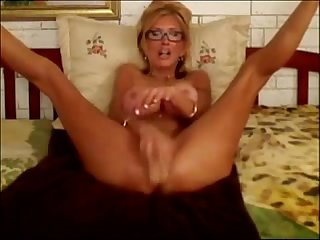 Sexy blonde teacher fucks herself in 3 holes with lots of toys