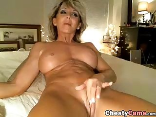 Hot sexy milf masturbates on the bed