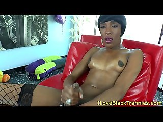 Ebony tgirl tugging her hard black cock