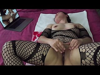 Asian milf pussy playing while watching porn in black stockings