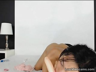 Petite brunette toys her ass on webcam