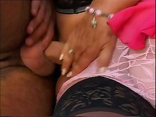 Fat mature woman with huge boobs sits on a hard cock