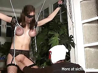 Brutally fisted busty slut in bondage