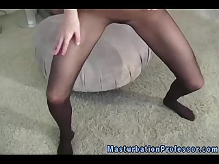 Stocking fetish babe shows off her box