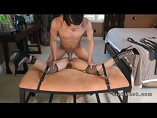 Bound brunette gags huge dick in bedroom