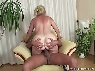 Busty mature lady and a black cock