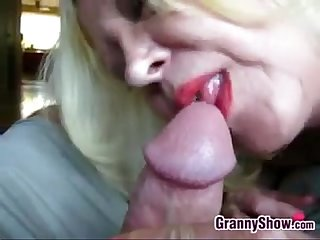Blonde grandma sucking cock close up