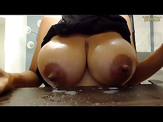 Cam girl sucks her own titties