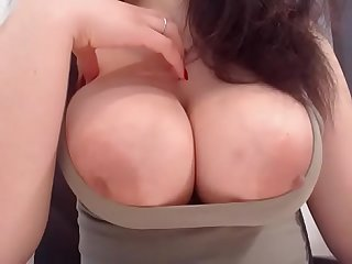 Slutty wife showing of big tits and nipples in tight shirt