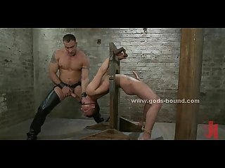 Strong athletic gay hunk with large tattooes in extreme rough bdsm fetish sex
