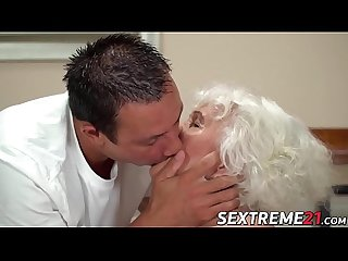 Short hair grandma teases with big tits before banging