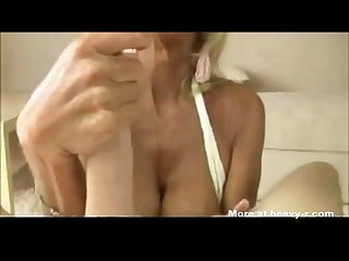 Old Woman Gives Titfuck