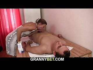 60 years old masseuse gets her hairy pussy drilled by client