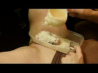 Boy cock encased in hot wax CBT